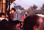 Children climbing to see over crowd