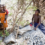 Young children working in the rock pit making gravel for sale in Gbanga, Bong County, Liberia.
