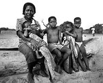 African mother and children on beach (Black and white)
