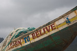 FREETOWN PENINSULA, SIERRA LEONE - AUGUST,2006: Learn to believe painted on the side of a fishing boat.  Beaches around the village of Sussex on the Freetown Peninsula. (Photo by: Christophe ...