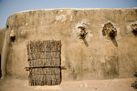 TAMBERNA VALLEY, TOGO - DECEMBER, 2006: A wall on the roof of a tat house. Located in the North of Togo, the Tamberma Valley is famous for it castle like mud houses called Tata. (Photo by: C ...