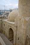 Baku, Azerbaijan - February 2008: Royal Mosque in the Palace of the Shirvan Shahs in Baku, Azerbaijan built in the 15 th century with the modern TV tower in the background. (Photo by Christo ...