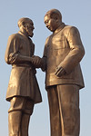 Hotan, Xinjiang, China - September 29, 2009: Communist propaganda statue of Chairman Mao shaking hands with a shorter Uyhgur man. (Photo by: Christopher Herwig)