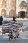 Yazd, Iran - February, 2008: Man on motorbike carrying a stack of carpets throu the busy Behesti Square at the heart of the ancient and vibrant desert city of Yazd. (Photo by Christopher Her ...