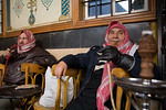 Damascus, Syria - January 2008: Two Syrian men smoking water pipes in a cafe in Damascus. (Photo by Christopher Herwig)