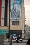 Aleppo, Syria - January, 2008: Poster of a smiling Syrian President Bashar al-Assad in downtown Aleppo. (Photo by Christopher Herwig)